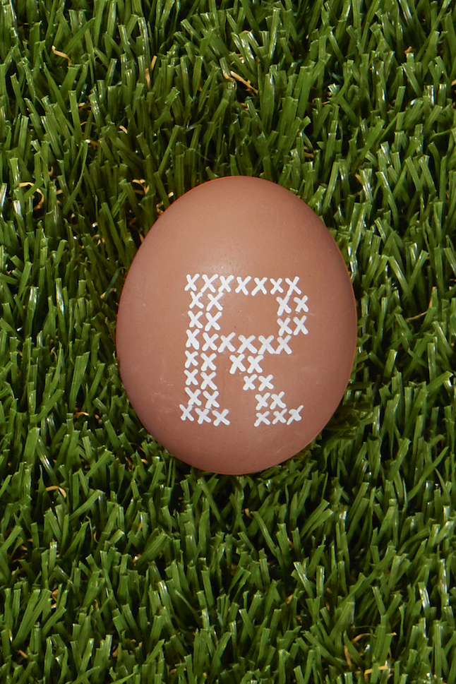 <p>Use a white paint pen to create a cross-stitch look to showcase your initial or your family monogram on an Easter egg. It's a great idea for a personalized detail you can place at every seat at the holiday table.</p>