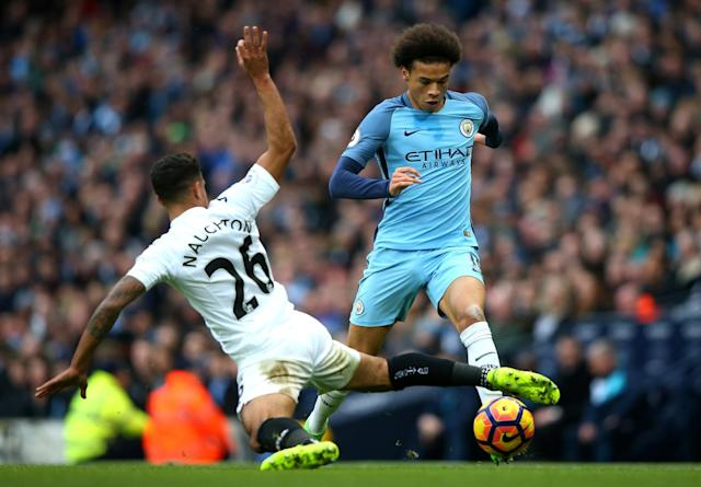 <p>Leroy Sane of Manchester City takes on Kyle Naughton of Swansea City during the Premier League match between Manchester City and Swansea City at Etihad Stadium on February 5, 2017 in Manchester, England. </p>