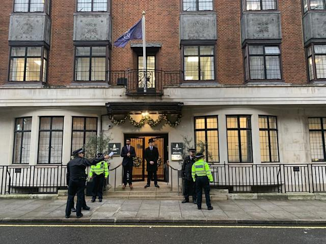 Police and hospital personnel guard outside King Edward VII's Hospital in London (PA)