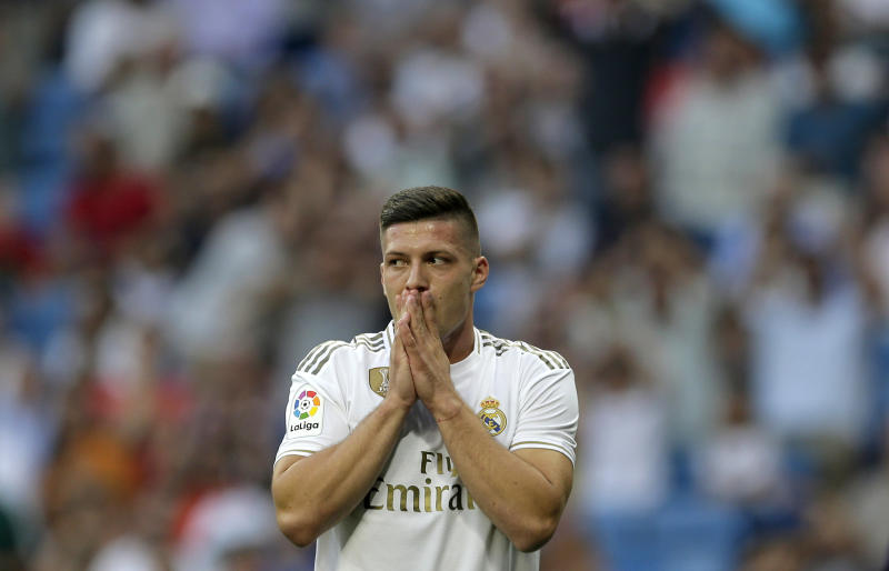 Real Madrid's Luka Jovic gestures during the Spanish La Liga soccer match between Real Madrid and Valladolid at the Santiago Bernabeu stadium in Madrid, Spain, Saturday, Aug. 24, 2019. (AP Photo/Paul White)