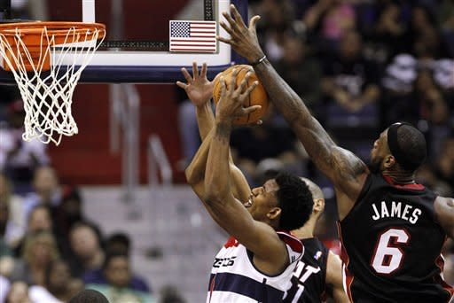 Washington Wizards guard Nick Young (1) shoots ahead of Miami Heat forward LeBron James (6) during the second quarter of an NBA basketball game in Washington, on Friday, Feb. 10, 2012. The Heat won 106-89. (AP Photo/Jacquelyn Martin)