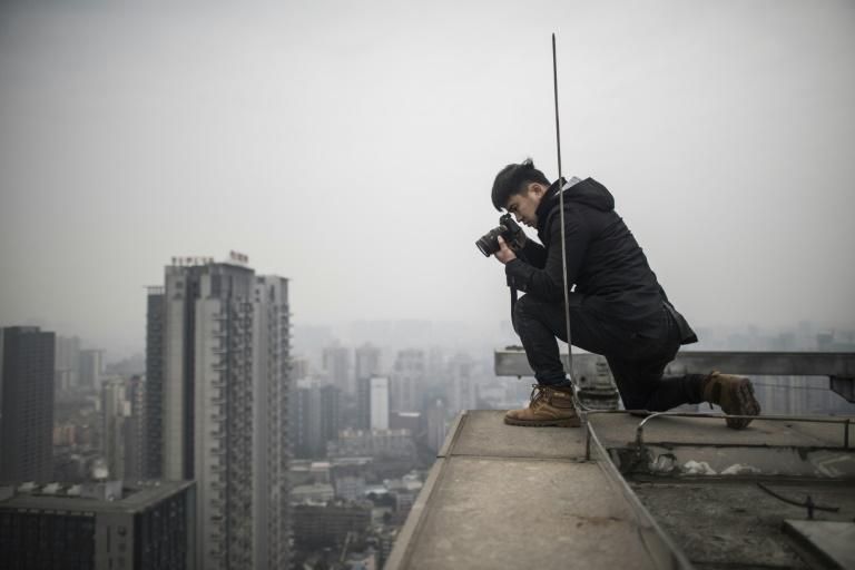 """Yan's pursuit of the perfect photo became even more complicated at the end of 2017 when a young Chinese """"rooftopper"""" fell, plunging 62 storeys to his death"""