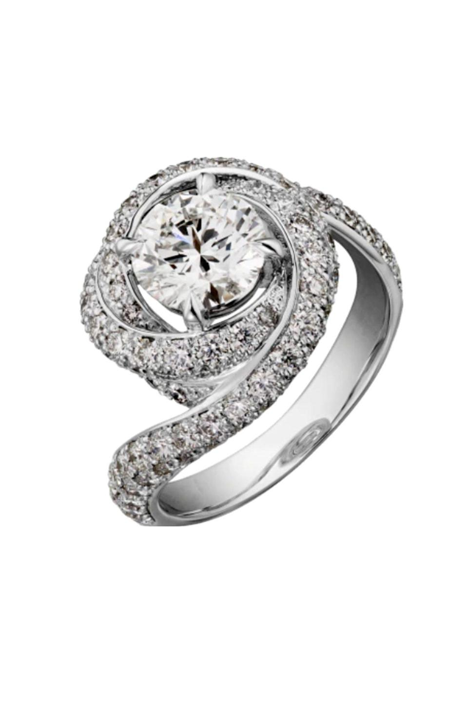 """<p><strong>Cartier</strong></p><p>cartier.com</p><p><a href=""""https://www.cartier.com/en-us/collections/engagement/engagement-rings/trinity-ruban/n4250400-trinity-ruban-solitaire.html"""" rel=""""nofollow noopener"""" target=""""_blank"""" data-ylk=""""slk:Shop Now"""" class=""""link rapid-noclick-resp"""">Shop Now</a></p><p>This Cartier engagement ring makes a bold, modern statement. </p>"""