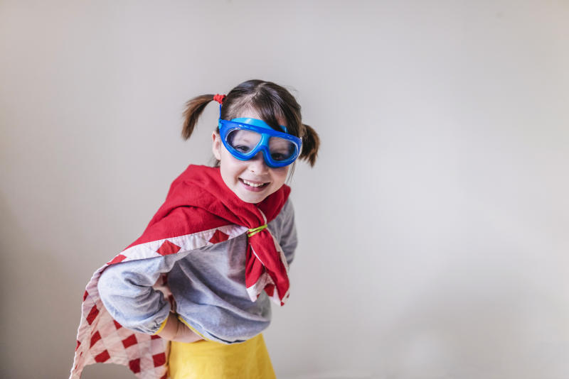 Little girl dressed in a homemade superhero outfit.