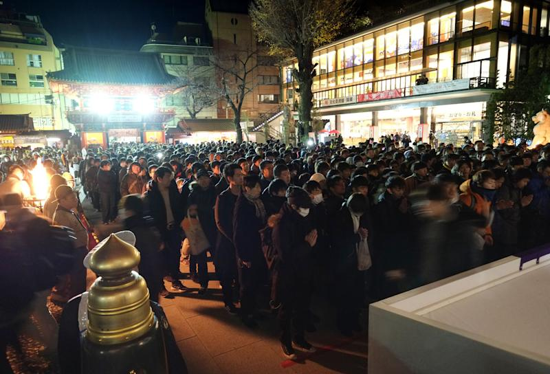 People visit Kanda Myojin Shrine to offer New Year prayers in Tokyo on January 1, 2019. Millions of Japanese people will visit shrines and temples across the country during the first three days of the new year to pray for the well-being of their families.