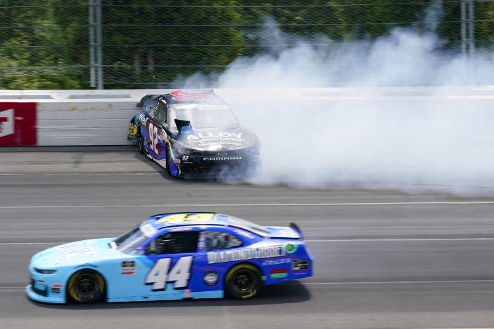 Josh Williams (92) hits the wall after spinning out going through turn one as Tommy Joe Martins (44) passes by during a NASCAR Xfinity Series auto race at Pocono Raceway, Sunday, June 27, 2021, in Long Pond, Pa. (AP Photo/Matt Slocum)