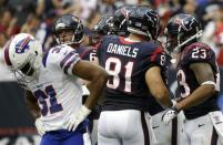 Buffalo Bills' Jairus Byrd (31) walks away as Houston Texans' Owen Daniels (81) and Arian Foster (23) celebrate Foster's touchdown in the third quarter of an NFL football game on Sunday, Nov. 4, 2012, in Houston. (AP Photo/David J. Phillip)