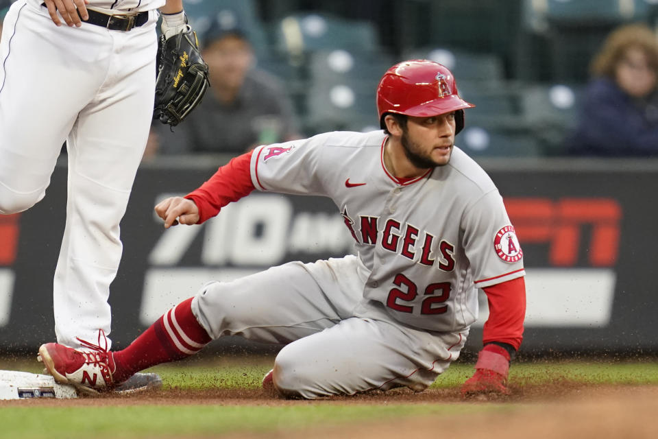 Los Angeles Angels' David Fletcher slides safely into third base against the Seattle Mariners with a steal during the fourth inning of a baseball game Saturday, May 1, 2021, in Seattle. (AP Photo/Elaine Thompson)