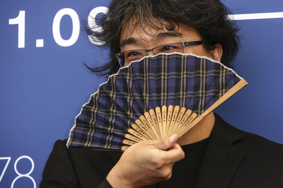 FILE - In this Sept, 1, 2021 file photo Jury president Bong Joon-ho poses for photographers at the photo call for the jury during the 78th edition of the Venice Film Festival in Venice, Italy (Photo by Joel C Ryan/Invision/AP, File)