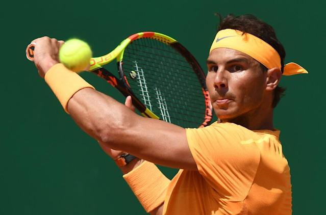 Feel his pain: Rafael Nadal on his way to victory over Dominic Thiem in Monte Carlo on Friday (AFP Photo/YANN COATSALIOU)