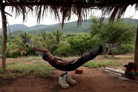 A member of the Community Police rests on a hammock at a checkpoint in the municipality of San Diego Xayakalan