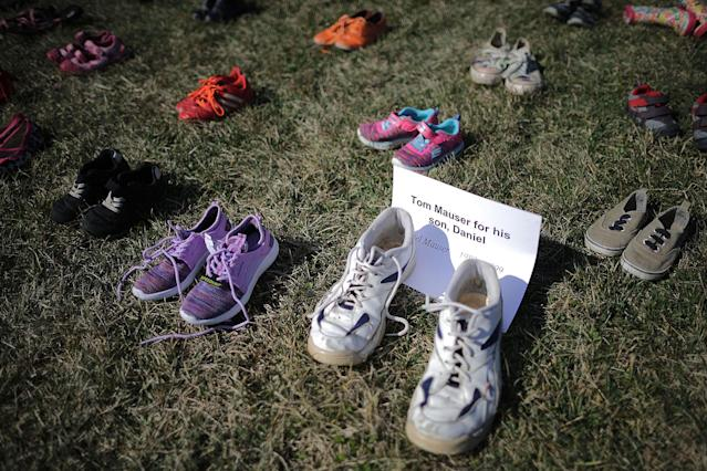 <p>7,000 pairs of shoes, representing the children killed by gun violence since the mass shooting at Sandy Hook Elementary School in 2012, are spread out on the lawn on the east side of the Capitol March 13, 2018 in Washington. (Photo: Chip Somodevilla/Getty Images) </p>