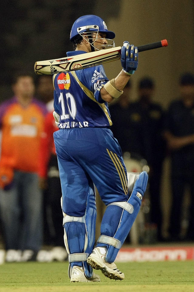Mumbai Indians' Sachin Tendulkar , after scoring a century during the Indian Premier League (IPL) cricket match against Kochi Tuskers Kerala in Mumbai, India, Friday, April 15, 2011.
