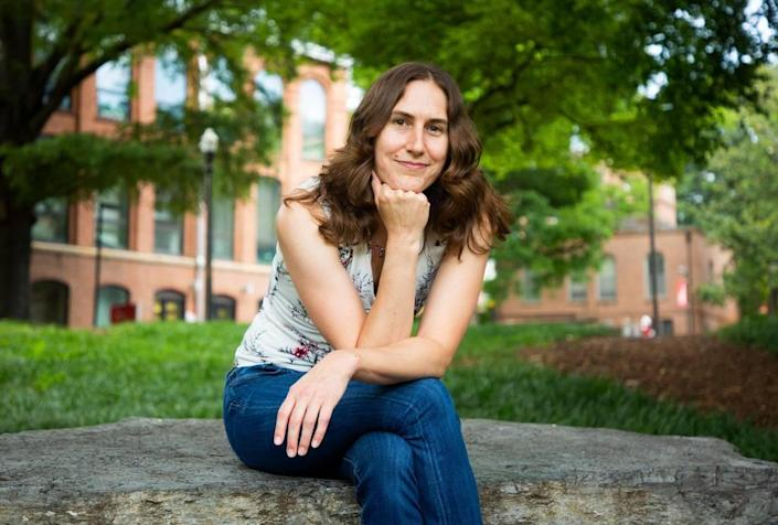 Katie Mack, an astrophysicist and assistant professor of physics at N.C. State University sits for a portrait on campus, on Monday, July 12, 2021, in Raleigh, N.C.
