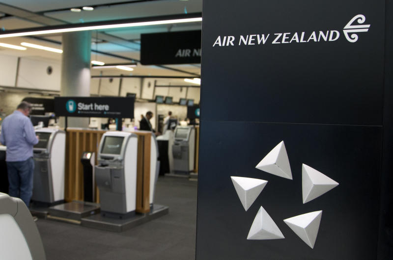 FILE - In this Sept. 20, 2017, file photo, passengers check in to their flights at Christchurch Airport in Christchurch, New Zealand. New Zealand's national carrier admitted a registration mistake turned back a flight to China over the weekend, prompting Prime Minister Jacinda Ardern to say Monday, Feb. 11, 2019, that politics were not involved.(AP Photo/Mark Baker, File)