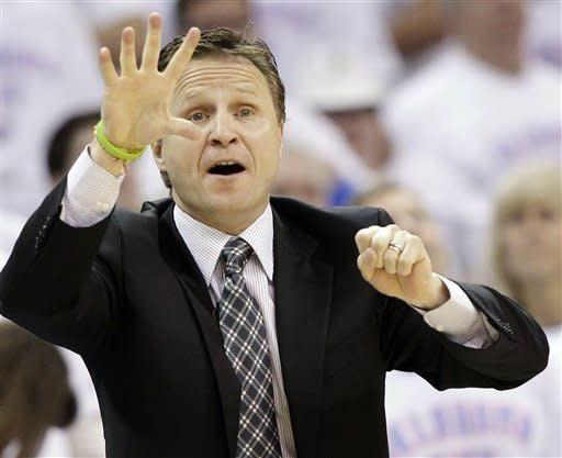 Oklahoma City Thunder head coach Scott Brooks reacts against the San Antonio Spurs during the first half of Game 6 in the NBA basketball Western Conference finals, Wednesday, June 6, 2012, in Oklahoma City. (AP Photo/Eric Gay)