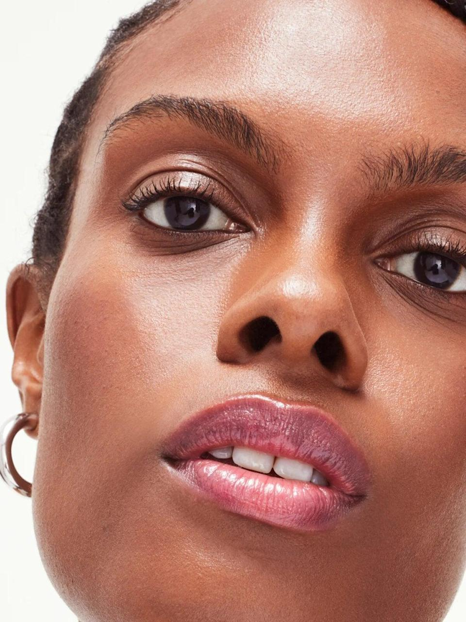 """<h2>Glossier Ultralip In Portait</h2><br>When <a href=""""https://www.refinery29.com/en-us/2021/05/10484446/glossier-ultralip-review"""" rel=""""nofollow noopener"""" target=""""_blank"""" data-ylk=""""slk:Glossier launched its Ultralip"""" class=""""link rapid-noclick-resp"""">Glossier launched its Ultralip</a> — a tinted lip balm meets lipgloss meets lipstick hybrid — readers carted it up as a new summer beauty favorite. The top-bought color was Portrait (pictured here), a hue our beauty writer described as """"the prettiest pink in existence"""" with balanced undertones that are perfect for everyday wear.<br><br><em>Shop <strong><a href=""""http://glossier.79ic8e.net/YgV91j"""" rel=""""nofollow noopener"""" target=""""_blank"""" data-ylk=""""slk:Glossier"""" class=""""link rapid-noclick-resp"""">Glossier</a></strong></em><br><br><strong>Glossier</strong> Ultralip, Portrait, $, available at <a href=""""https://glossier.79ic8e.net/YgV91j"""" rel=""""nofollow noopener"""" target=""""_blank"""" data-ylk=""""slk:Glossier"""" class=""""link rapid-noclick-resp"""">Glossier</a>"""