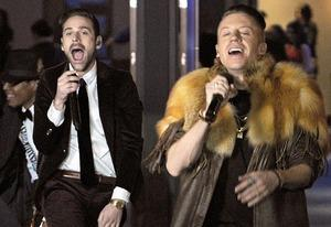 Ryan Lewis, Macklemore   Photo Credits: Robyn Beck/AFP/Getty Images