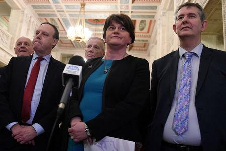 FILE PHOTO: DUP leader Arlene Foster (C) arrives at a news conference in Parliament Buildings at Stormont in Belfast, Northern Ireland February 12, 2018. REUTERS/Clodagh Kilcoyne/File Photo