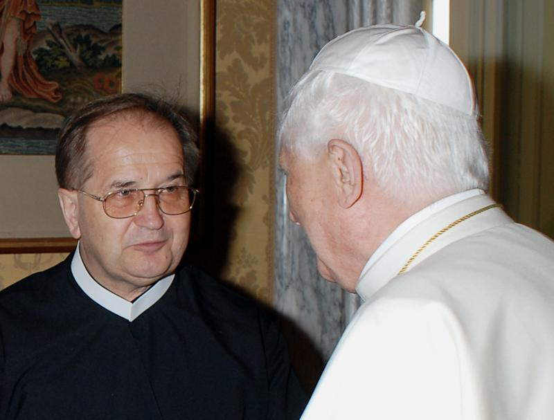 "FILE - In this Aug. 5, 2007 file picture made available by the Vatican newspaper L'Osservatore Romano, Pope Benedict XVI shakes hands with Rev. Tadeusz Rydzyk in Castel Gandolfo on the hills overlooking Rome. Rydzyk, a controversial Polish priest and media mogul has sparked an uproar in Poland by calling the country a ""totalitarian state"" that ""hasn't been ruled by Poles since 1939"", a statement many interpret as code for saying Jews are secretly running the country. The priest, who has been accused in the past of fomenting anti-Semitism through his politically influential, ultra-Catholic radio station Radio Maryja, made the comments at the European Parliament last week. (AP Photo/L'Osservatore Romano, File)  EDITORIAL USE ONLY"