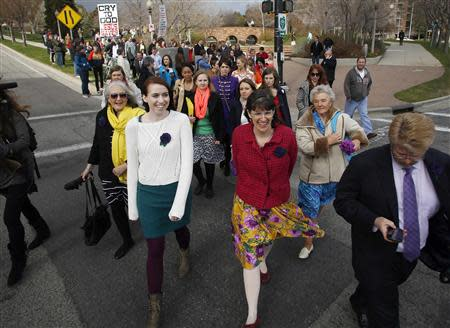 A group of Mormon women walk to Temple Square in an attempt to get tickets to the priesthood meeting at the The Church of Jesus Christ of Latter-day Saints semi-annual gathering known as general conference in Salt Lake City, Utah April 5, 2014. REUTERS/Jim Urquhart