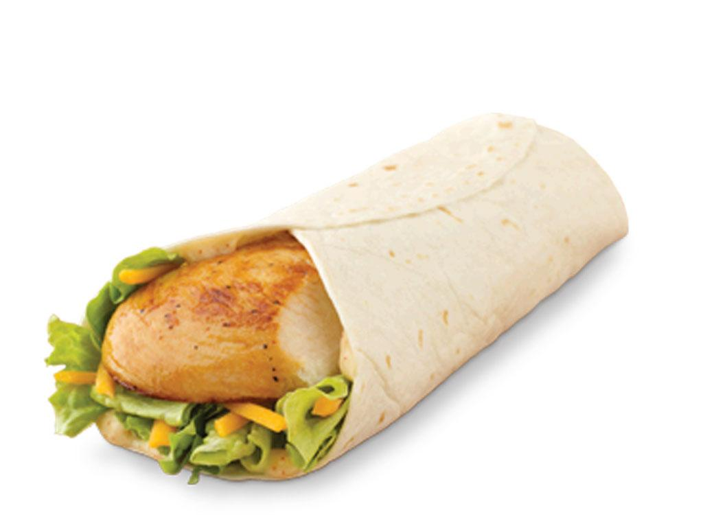 <div>270 calories, 10 g fat (3.5 g saturated fat, 0 g trans fat), 640 mg sodium, 24 g carbohydrates (2 g fiber, 3 g sugar), 20 g protein</div>         Crisp lettuce, cheddar cheese, and grilled chicken breast will help you get your fill of muscle-building protein, minus the high fat and carb count. You'll consume almost a fourth of the calories with the wrap compared to the burger, too.