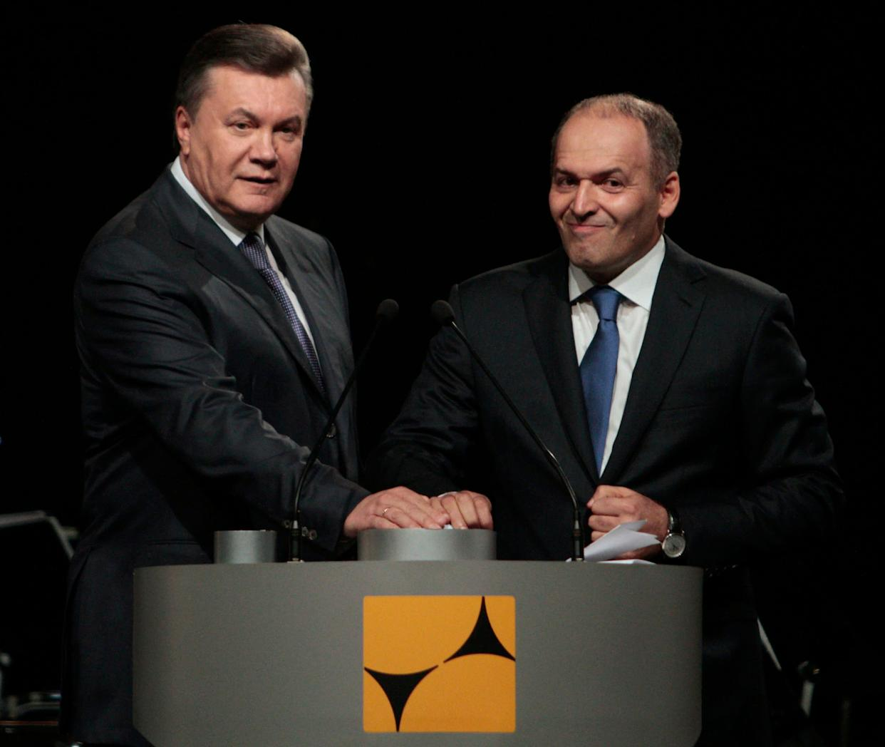 Ukraine's former president Viktor Yanukovych and tycoon Viktor Pinchuk take part in a ceremony to open a new steel mill on Oct. 4, 2012. (Photo: Anatolii Stepanov / Reuters)