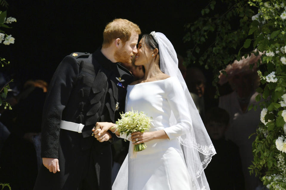 The crowd cheered as Harry and Meghan kissed at the top of the steps.