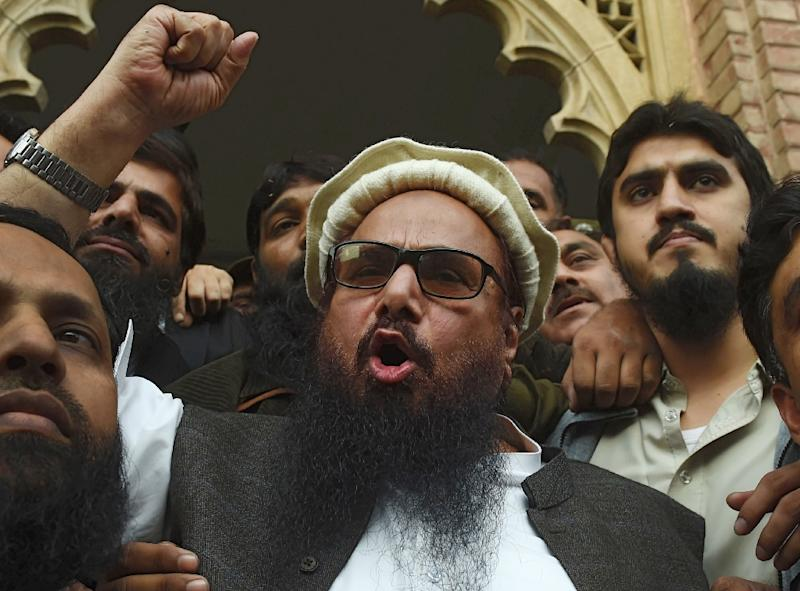 Firebrand cleric Hafiz Saeed (C) speaks to the media after his release order outside a court in Pakistan