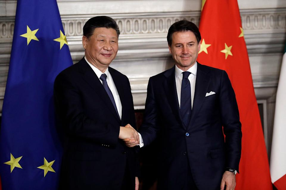Chinese President Xi Jinping, left, and Italian Premier Giuseppe Conte shake their hands at the end of the signing ceremony of a memorandum of understanding at Rome's Villa Madama, Saturday, March 23, 2019. Jinping is in Italy to sign a memorandum of understanding to make Italy the first Group of Seven leading democracies to join China's ambitious Belt and Road infrastructure project. (AP Photo/Andrew Medichini)