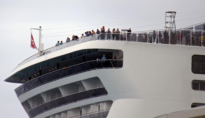 """Passengers remain aboard the MSC Meraviglia cruise ship in Cozumel, Mexico, on Feb. 27, 2020. <span class=""""copyright"""">(Jose Castillo / AFP/Getty Images)</span>"""