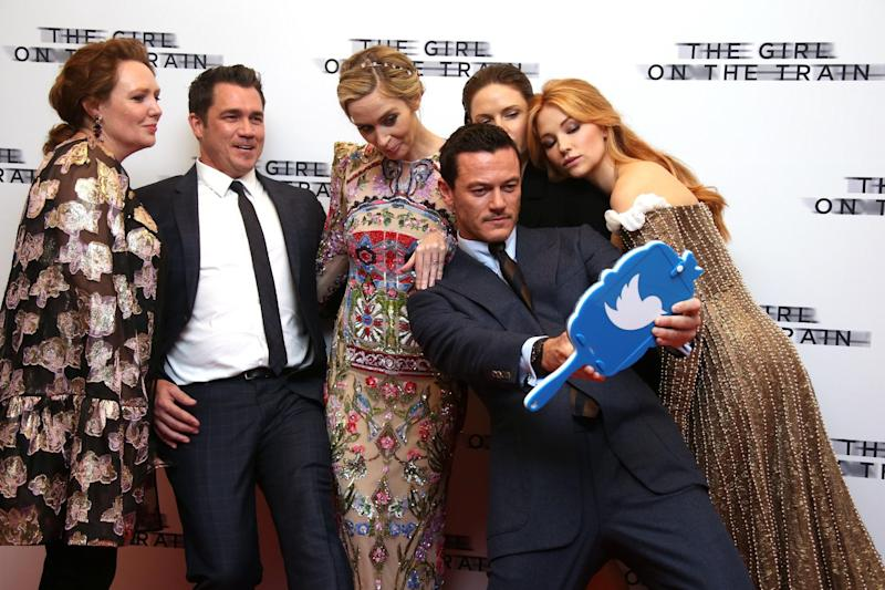 Actors, from right, Haley Bennett, Rebecca Ferguson, Luke Evans, Emily Blunt, director Tate Taylor and author Paula Hawkins pose for photographers upon arrival at the premiere of the film 'The Girl On The Train' in London, Tuesday, Sept. 20, 2016. (Photo by Joel Ryan/Invision/AP)