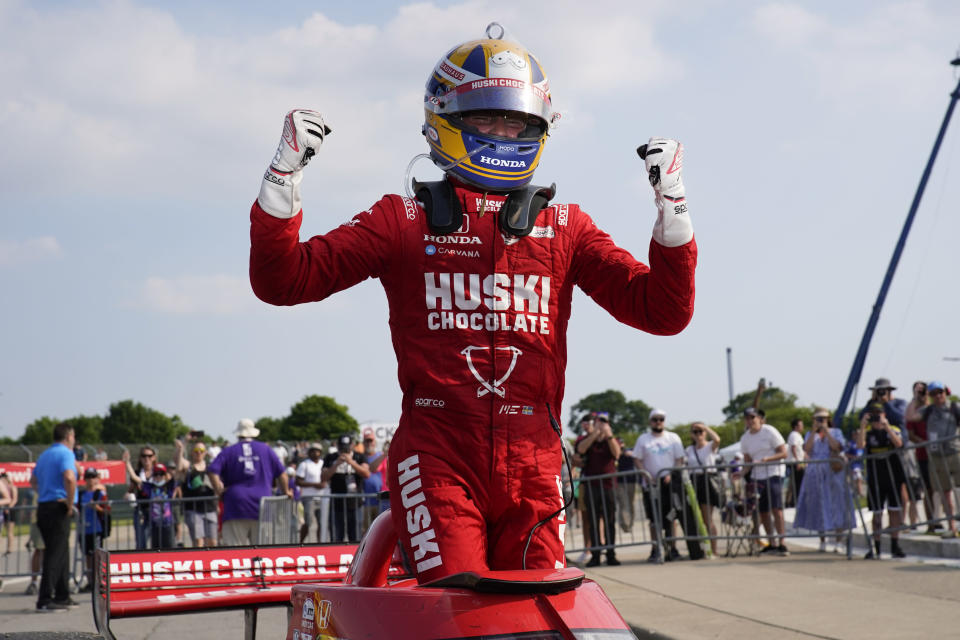 Marcus Ericsson, of Sweden, celebrates winning the first race of the IndyCar Detroit Grand Prix auto racing doubleheader on Belle Isle in Detroit Saturday, June 12, 2021. (AP Photo/Paul Sancya)