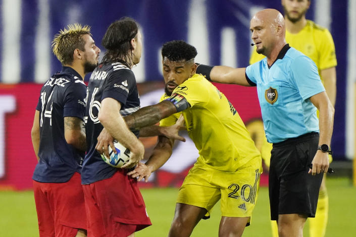 Nashville SC midfielder Anibal Godoy (20) pulls the ball out of the grasp of New England Revolution midfielder Thomas McNamara (26) during the first half of an MLS soccer match Friday, Oct. 23, 2020, in Nashville, Tenn. (AP Photo/Mark Humphrey)