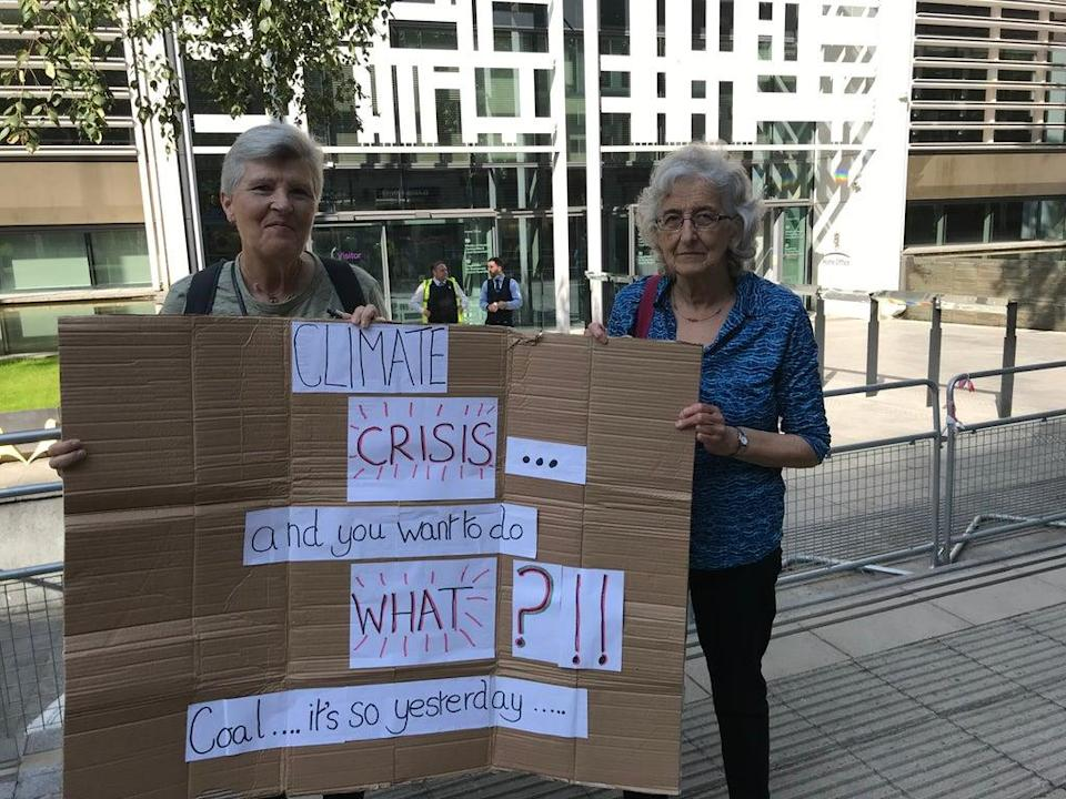 Pamela Laurence (R) and Jill Cass (L) protest in London. (Rory Sullivan)