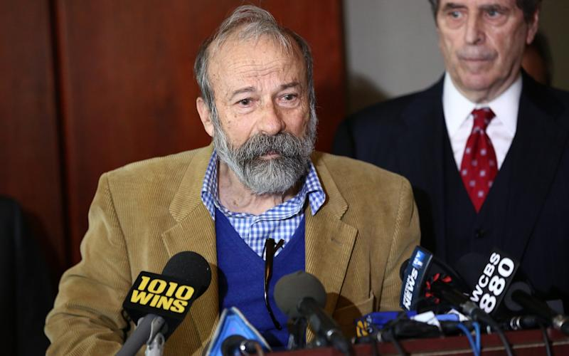 Arturo Di Modica speaks at a press conference addressing legal rights over the Fearless Girl installation on Wall Street  - Credit: Getty Images