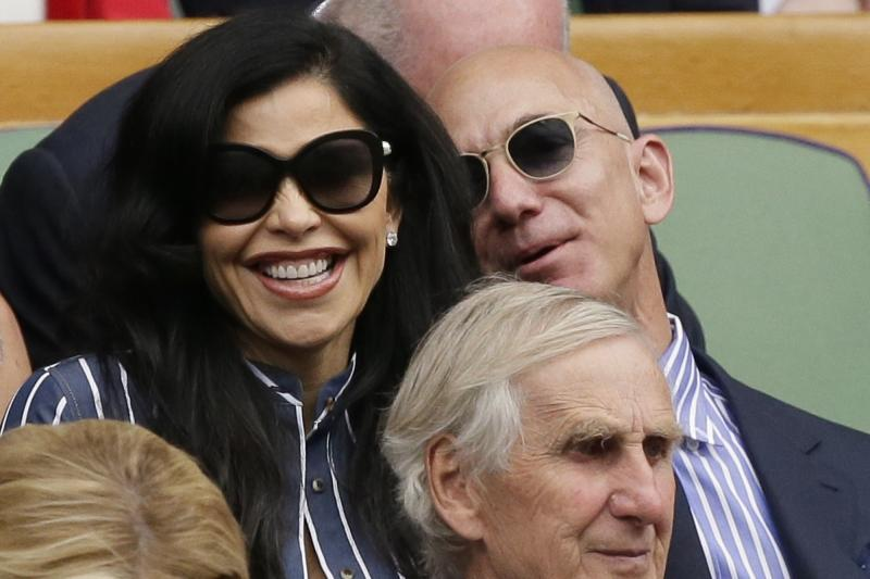 Amazon founder Jeff Bezos and Lauren Sanchez sit in the Royal Box to watch the men's singles final match of the Wimbledon Tennis Championships in London, Sunday, July 14, 2019. (AP Photo/Tim Ireland)