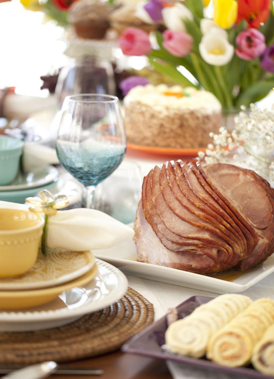 """<p>Although the choice of what to serve for Easter dinner might come down to taste preference, for others the menu holds great significance.</p><p>In early Jewish history, <a href=""""https://www.goodhousekeeping.com/food-recipes/a47680/spiced-lamb-dumplings-recipe/"""" rel=""""nofollow noopener"""" target=""""_blank"""" data-ylk=""""slk:lambs"""" class=""""link rapid-noclick-resp"""">lambs</a> were sacrificed as offerings to God and served regularly as part of the Passover feast. Then, when Jesus died during Passover, he represented the ultimate sacrifice for sin, the """"<a href=""""https://www.thespectrum.com/story/life/2018/04/06/music-times-lamb-god-transformative-engaging-experience/494276002/"""" rel=""""nofollow noopener"""" target=""""_blank"""" data-ylk=""""slk:lamb of God"""" class=""""link rapid-noclick-resp"""">lamb of God</a>,"""" and the animal evolved into a potent symbol for Christians, especially at Easter. Many Orthodox Christians still follow the Jewish Orthodox customs of not eating any pork, so lamb takes center stage at their Easter meal.</p><p>Others, however, wouldn't imagine Easter without <a href=""""https://www.goodhousekeeping.com/holidays/easter-ideas/g881/ham-recipes/"""" rel=""""nofollow noopener"""" target=""""_blank"""" data-ylk=""""slk:ham"""" class=""""link rapid-noclick-resp"""">ham</a>. Symbolizing """"good luck"""" for many cultures around the world, it made a fitting meal at all sorts of celebrations, according to the <a href=""""http://religion.oxfordre.com/"""" rel=""""nofollow noopener"""" target=""""_blank"""" data-ylk=""""slk:Encyclopedia of Religion"""" class=""""link rapid-noclick-resp"""">Encyclopedia of Religion</a>. Some historians believe Easter's spring timing also factored into the choice: Farmers typically slaughtered pigs in the fall and then took several months to smoke the <a href=""""https://www.goodhousekeeping.com/food-recipes/easy/a47532/pork-chops-with-balsamic-braised-cabbage-and-apples-recipe/"""" rel=""""nofollow noopener"""" target=""""_blank"""" data-ylk=""""slk:pork"""" class=""""link rapid-noclick-resp"""">pork</a>, making a ham ready just in time for Easte"""