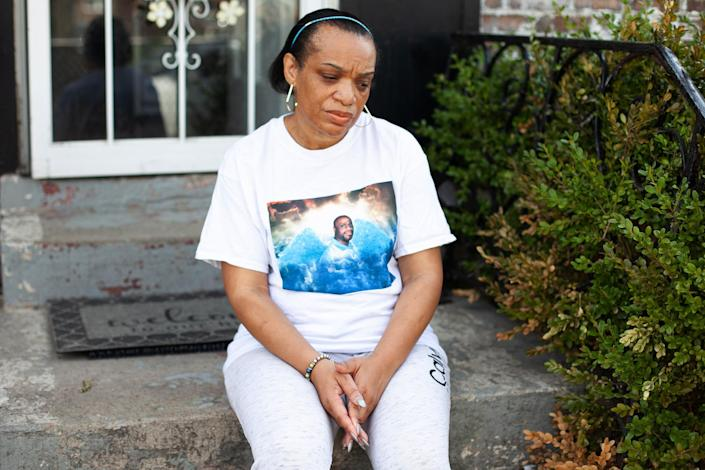 Image: Angela McMiller outside her home in Chicago (Eddie Quinones / for NBC News)