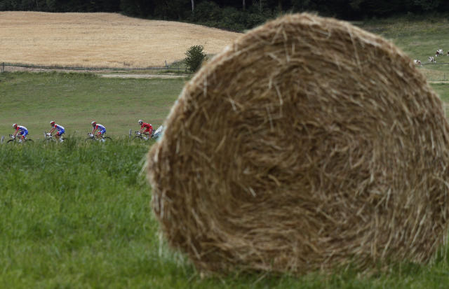 Riders pass next to bales of straw during the seventh stage of the Tour de France cycling race over 230 kilometers (142,9 miles) with start in Belfort and finish in Chalon sur Saone, France, Friday, July 12, 2019. (AP Photo/Thibault Camus)