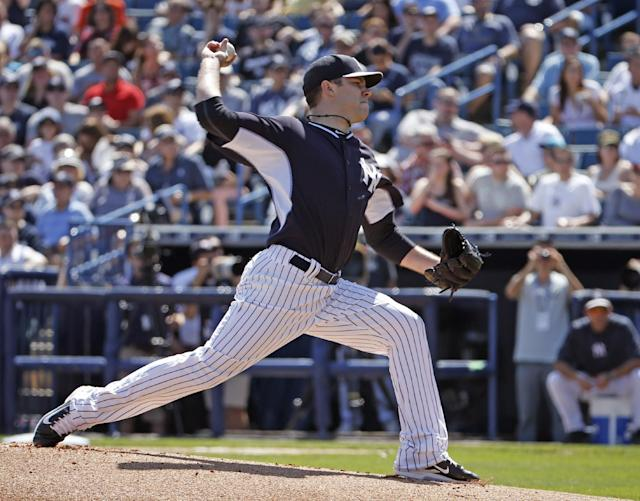 New York Yankees starting pitcher David Phelps delivers in the first inning of a spring training baseball game against the Tampa Bay Rays in Tampa, Fla., Sunday, March 9, 2014. (AP Photo/Kathy Willens)
