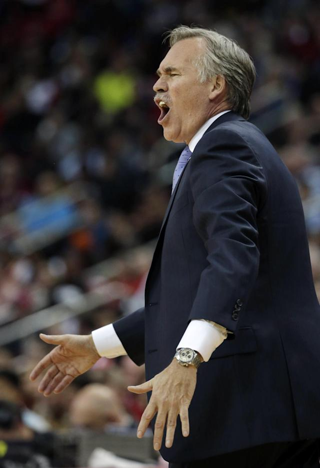 Los Angeles Lakers coach Mike D'Antoni reacts to a call during the second quarter of an NBA basketball game against the Houston Rockets Thursday, Nov. 7, 2013, in Houston. (AP Photo/David J. Phillip)