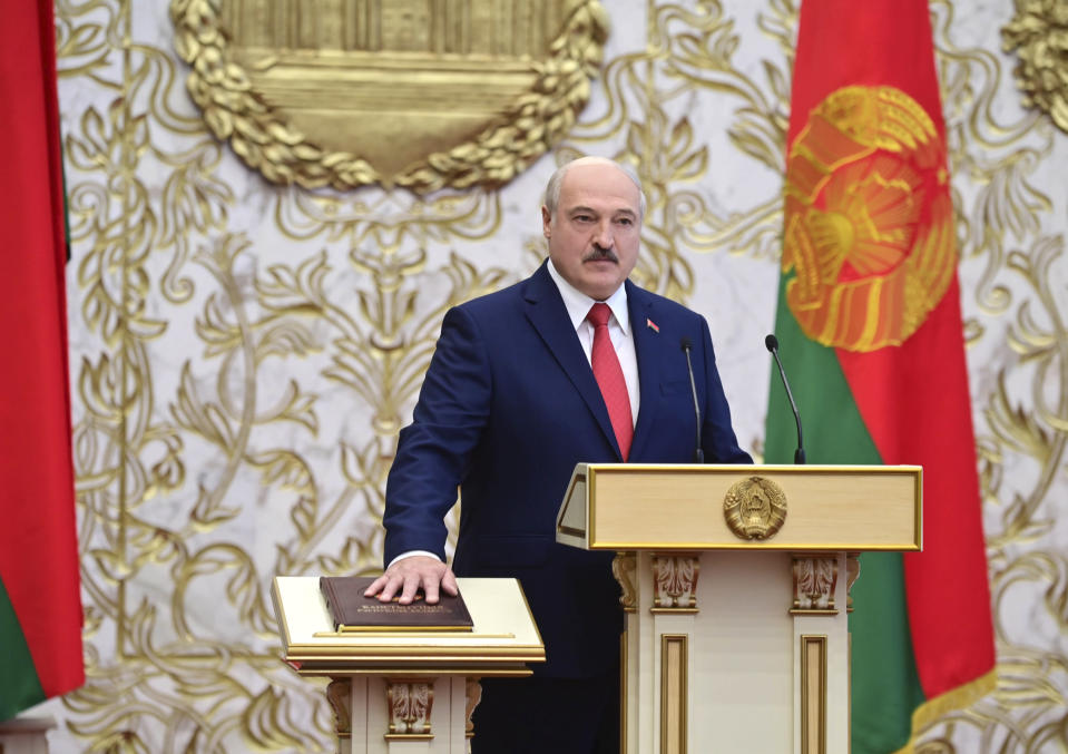 FILE - In this file pool photo taken on Wednesday, Sept. 23, 2020, Belarusian President Alexander Lukashenko takes his oath of office during his inauguration ceremony at the Palace of the Independence in Minsk, Belarus. Belarus President Alexander Lukashenko has relied on massive arrests and intimidation tactics to hold on to power despite nearly three months of protests sparked by his re-election to a sixth term, but continuing protests have cast an unprecedented challenge to his 26-year rule. (Andrei Stasevich/Pool Photo via AP, File)