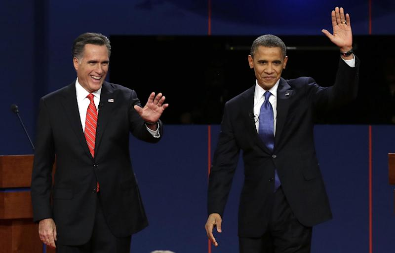 "FILE - In this Oct. 3, 2012, file photo, Republican presidential candidate Mitt Romney and President Barack Obama wave to the audience during the first presidential debate at the University of Denver in Denver. The sixth ""town hall"" style presidential debate will bring Obama and Romney to Hofstra University on New York's Long Island Tuesday, Oct. 16, 2012. They'll take questions from undecided voters selected by Gallup. (AP Photo/Charlie Neibergall, File)"