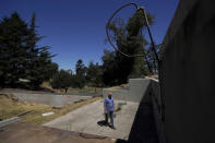 """Will Abrams walks on the lot of his family home that was destroyed by wildfires in 2017 while interviewed in Santa Rosa, Calif., Thursday, June 24, 2021. Pacific Gas & Electric's CEO is pledging that the future will get """"easier"""" and """"brighter."""" But those words are ringing hollow one year after PG&E emerged from a complex bankruptcy triggered by a succession of harrowing wildfires ignited by its long-neglected electrical grid. (AP Photo/Jeff Chiu)"""