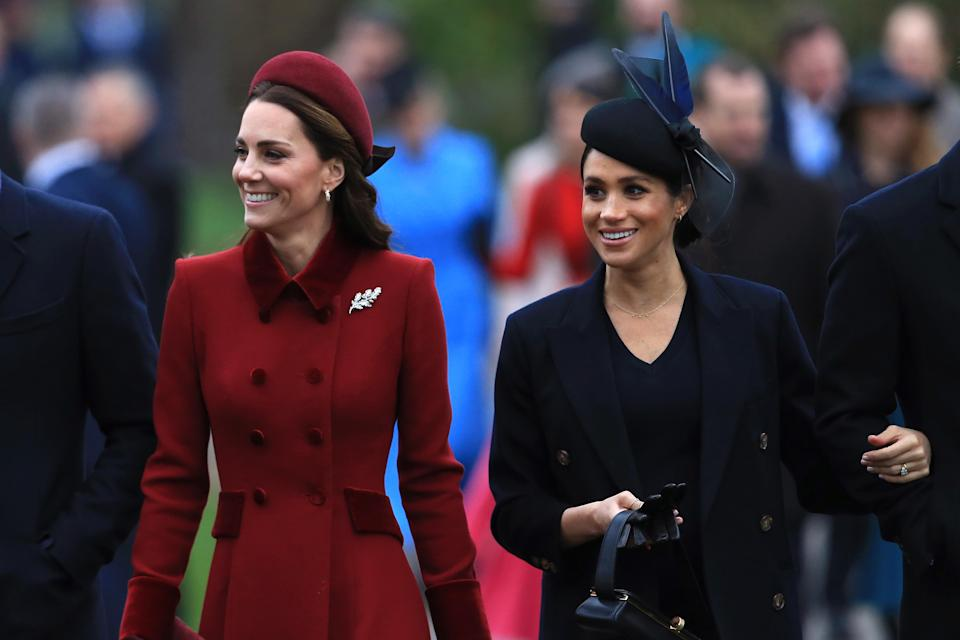 Kate wore a burgundy Catherine Walker coat, while Meghan was in navy [Photo: Getty]