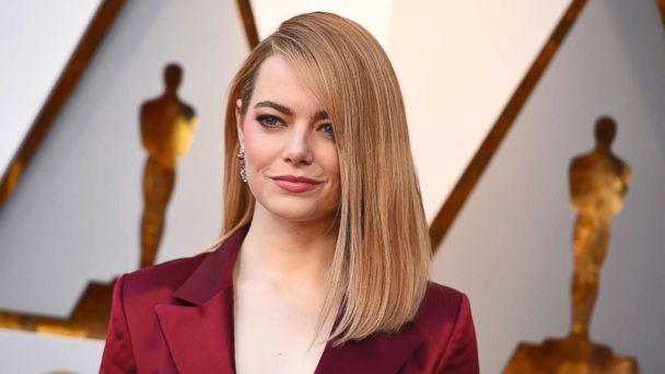 PHOTO: Emma Stone arrives at the Oscars in Los Angeles on March 4, 2018.  (Jordan Strauss/Invision via AP)