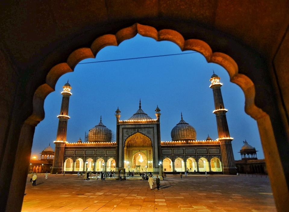 NEW DELHI, INDIA - JULY 31: A view of Jama Masjid illuminated on the eve of Eid-al Adha festival, on July 31, 2020 in New Delhi, India. The holy festival of sacrifice, which falls on the 10th day of Dhu al-Hijjah as per the Islamic lunar calendar, is being celebrated today. Bakra Eid or Bakrid is marked by sacrificing an animal that is close to them to prove their devotion and love for Allah. Post the sacrifice, devotees distribute the offering to family, friends, neighbours and especially to the poor and the needy. (Photo by Raj K Raj/Hindustan Times via Getty Images)