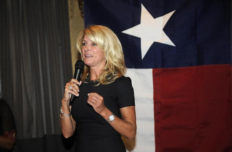 FILE - In this Thursday, July 25, 2013 file photo, Texas State Sen. Wendy Davis, famous for her 12-hour filibuster attempt against an anti-abortion rights bill, speaks at a fundraiser in Washington. Unforced errors by GOP front-runners to replace Gov. Rick Perry, when he steps aside in 2014 have given Texas Democrats, a little hope in winning a statewide office for the first time in 20 years. But as they wait for Davis' expected Oct. 3 announcement that she will run, they're left without a candidate to pounce on their rivals' missteps. (AP Photo/Nick Wass)
