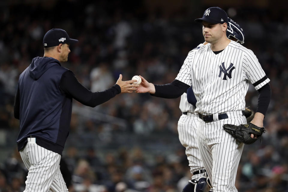BRONX, NY - OCTOBER 15:  Manager Aaron Boone #17 of the New York Yankees takes the ball from Adam Ottavino #0 during a pitching change during Game 3 of the ALCS between the Houston Astros and the New York Yankees at Yankee Stadium on Tuesday, October 15, 2019 in the Bronx borough of New York City. (Photo by Rob Tringali/MLB Photos via Getty Images)